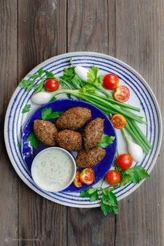Authentic Middle Eastern kibbeh recipe with step-by-step tutorial. Delicious stuffed croquetts made w/ bulgur wheat, ground beef or lamb & toasted pine nuts