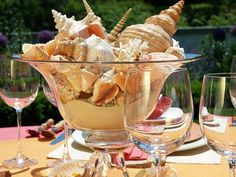 Seashell centerpiece - a big glass bowl, sand and shells, simple yet elegant tablescape center - perfect for a beach wedding too.