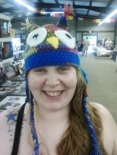 Adult owl hat , mulit  color with blue boarder and braided ties