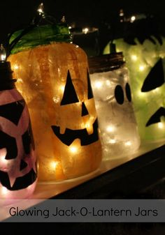 Glowing Jack O Lanterns made from recycled jars & tissue papaer