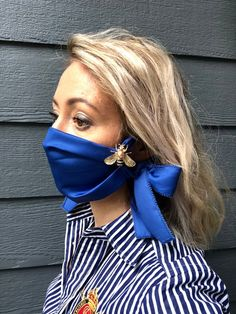 face mask fashion This Trendy fashionable cloth face mask is perfect for the woman on the go in Not only is it ultra stylish but it will also help to prevent the spread of germs. For more great womens face masks be sure to check out our link. Diy Mask, Diy Face Mask, Face Masks, Blue Mask, Creation Couture, Great Women, Fashion Face Mask, Mask Design, Design Art