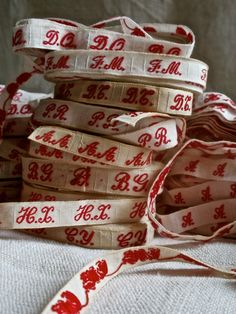 French laundry woven monogrammed tape unused many initials available traditional red thread on white cotton. £9.50, via Etsy.