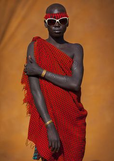 Bodi Tribe Young Woman With Sunglasses, Hana Mursi, Omo Valley, Ethiopia (by Eric Lafforgue)