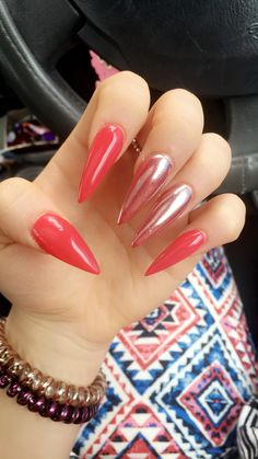 Red stiletto nails with pearl shine