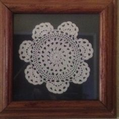 Easy to make. Small doily glued on mat board and framed. Simple and inexpensive.
