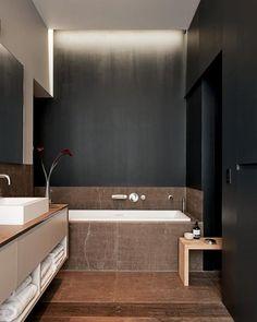 bathroom . dark & sleek . brown inca stone with black walls . Karin Leopold & Francois Fauconnet, architects