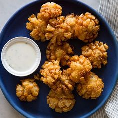 We're just about a week away from Super Bowl Sunday and I'm sure everyone is busy searching the internets for snack ideas for the big game! Today we have our last recipe repost (before giving you guys some awesome, new stuff….3 new recipes, before this Sunday, to be exact!). It's our baby bloomin' onions!! Yes, these little guys are a little time consuming, but they can be prepped a head of time…all the way up...KEEP READING!