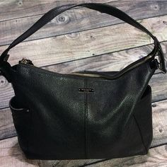 Kate Spade black purse Previously loved black Kate Spade shoulder purse.  Black soft leather exterior and green interior. Inside has two slip pockets and one zipper pocket. Outside has two small side pockets. Inside has some stains as shown in the pictures. Outside is in great condition.  Offers welcomed. No trades.  Same or next day shipping! Thanks for looking! kate spade Bags Shoulder Bags
