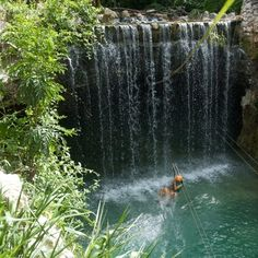 Ziplining through a waterfall in Mayan Riviera…