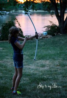 PVC Bow and Arrow Tutorial.   Challenges: 1.Dip the tip of the triangle in paint and shoot at a big paper target. 2.How far can you shoot. Use cones as markers. 3. Stack plastic cups to knock down.