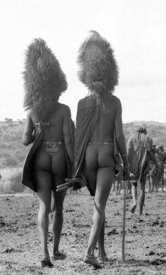 Africa | Maasai Warriors with lion mane headdress, Loita Hills, Kenya 1967.  | Photographer Mirella Ricciard