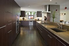 Countertop, flooring, cabinetry: Examples of 'mocha' concrete countertop, polished; Chocolate wood cabinets by Wenge and distressed dark chocolate stained oak  flooring. Houzz photo, Oakland Hills Remodel by Camber Construction.