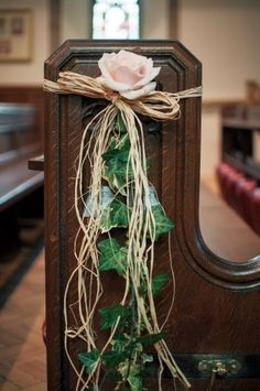 single rose and ivy to reserve church pews for a wedding ceremony