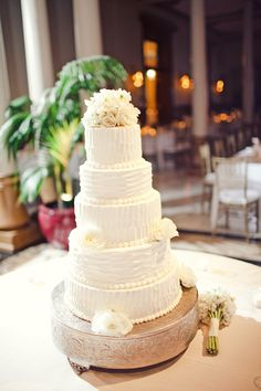 5 Tiered wedding cake with fresh flowers. Photo by The Nichols.
