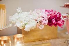 pink and white ombre flower centerpiece - hot pink, blush pink and white roses arranged in an ombre pattern inside a gold brushed rectangular vase