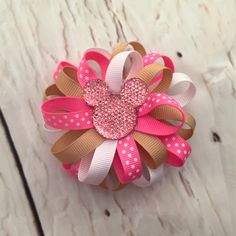A personal favorite from my Etsy shop https://www.etsy.com/listing/470477298/pink-gold-minnie-mouse-inspired-flower