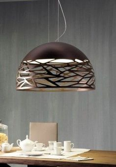 Pendant light with decorative cut-outs.