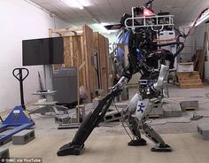 Researchers reveal Ian the Atlas robot can now vacuum, sweep and even put the trash away *