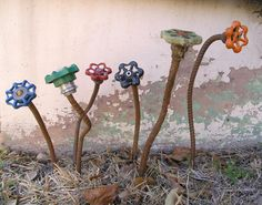 rebar & faucet handles in the garden...cute! -- could use copper tube (easier to work with)