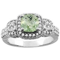 White Gold Green Amethyst Cushion Cut Diamond Engagement Ring - Green is not only good for the environment but a great thing for a loving environment comes this White Gold Green Amethyst Cushion Cut Diamond Engagement Ring in 10k White Gold in a Prong setting featuring a Green Cushion cut center stone with White Round and Princess cut accent stones on the mount and shank. The White Gold Green Amethyst Cushion Cut Diamond Engagement Ring has a gem weight of 1.70 carats. #unusualengagementrings