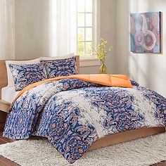 Create a unique look in your bedroom with the Minnet Reversible Comforter Set by Intelligent Design. This bold, updated paisley gives a room fresh new style with its vibrant colors and design, and reverses to a solid orange for an alternative look.