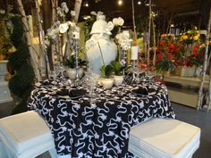 """Check out one of the two """"Table of the Months"""" for June! The linens are available to rent. This look is very elegent with the white flowers embroidered on."""