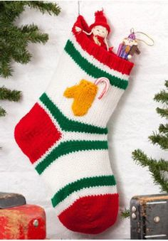 Traditional Holiday Stocking with Tiny Mitten Pocket - knit pattern  By: Lorna Miser for Red Heart Yarn