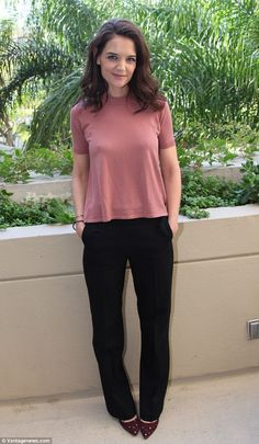 Elegant: Katie Holmes looked relaxed and radiant as she hosted a press conference for Touched With Fire in Beverly Hills, California, on Thursday