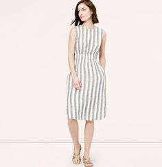 "Conveniently pocketed - and crafted with a hidden elastic waist - this striped midi is effortlessly easy. Jewel neck. Sleeveless. Slash pockets. Keyhole detail at back neck with button closure. Vented shirttail hem. 24 1/2"" from natural waist."
