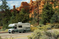 Tioga Class C motorhome driving on Utah highway 12 through Red Canyon in Dixie National Forest