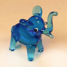 Glass Blown Art Figurine Animal Mini Blue Elephant Murano Style # 4394.  sc- I used to get these at places like San Diego Zoo, or other amusement parks, usually for ten cents each!