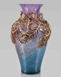 A lovely vase to adorn your home, Jay Strongwater knows how to bring alive the magnificent peacock through this collection! http://www.luxuryfacts.com/index.php/sections/article/3633