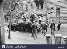 Prague, Czechoslovakia. End of the Prague Spring, a period of political liberalization in Czechoslovakia during the era of its domination by the Soviet Union after World War II. Czech children playing on a burnt out Russian tank. August 1968. Stock Photo