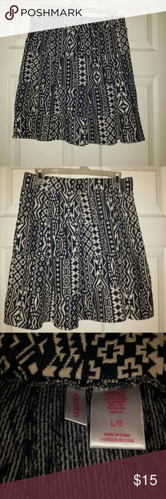 Xhilaration skirt Made of cotton,  polyester and spandex  Black and white geometric design shapes Waist is elastic and 15 inchs wide Length is 19 inches Xhilaration Skirts A-Line or Full