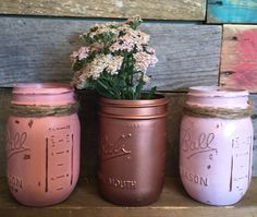 Set of three pint size mason jar #vases in coral, #copper, and pink. You can choose this color scheme or choose your own. This would look perfect as a centerpiece on your din... #jars #gifts #rustic #distressed