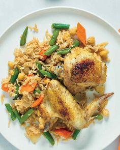 Moroccan Chicken and Rice with Chickpeas | Martha Stewart Living - Cumin and cinnamon evoke the flavors of North Africa in this chicken, rice, and vegetable casserole.