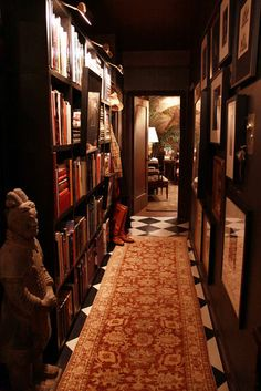 Books on one side and a photo/art gallery on the other. This space is so oldschool. The black & white parlor floors, the antique rug, the dark woods, and the walls full of memories and good stories. Nostalgia everywhere.