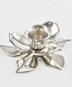 Silver flower shaped candle stand