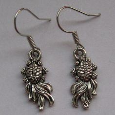 Goldfish Earrings for sale at Trendy Goodies. http://www.trendygoodies.nl/goudvis-oorbellen