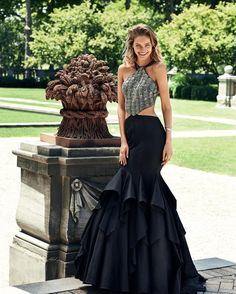Have a grand entrance when you arrive to your next event in this Taffeta Ruffled Mermaid Prom Dress by Alyce Paris. This style features a modern halter neckline with spaghetti straps, a ruffle tiered mermaid skirt, and side cut outs that lead to an open back for maximum impact.  #edressme