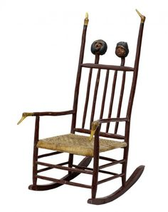 "Antique ""Moses Ogden Folk Art Rocking Chair"" .... Attributed To Craftsman, Moses Ogden, (1844-1919) from Angelica, New York. Rocking Chair has a rush seat, and handcarved from ""Burl, male and female black Americana carved heads"" on the chair back, and ""duck head carvings"" on chair arms and top of chair back."