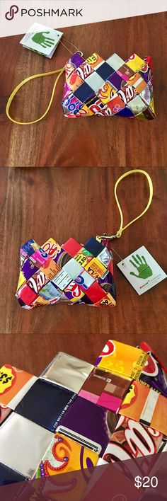 Candy Wrapper Wristlet This adorable recycled wrapper wristlet is super colorful, shiny and fun! There are recognizable candy bars and bottle wrappers on here like Coca-Cola! It's a perfect statement piece and is perfect to keep your money and lipstick in! ecoist Bags Clutches & Wristlets