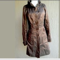 "RIANI Coat/ Dress Size 6 Nwot Very Avante-garde lightweight coat /dress size 6. Bronze metallic shimmer with ribbon and bead detailing. Beautifully constructed. Button up front with front pockets. New without tags.   Armpit to armpit 17"" Waist 30"" Length 32"" Shoulder to shoulder 14.5"" Sleeve, shoulder to cuff 23.5"" Posted with eBay Mobile RIANI Dresses"