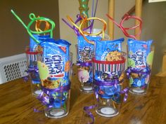 Kids Party Favors, great for a Mik & Cookie themed party.  A cup, a packaged of cookies and a crazy straw