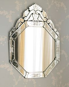 """#ONLYATNM Only Here. Only Ours. Exclusively for You. Venetian-style octagonal wall mirror framed with smaller mirrors featuring hand-etched detailing. 30""""W x 1""""D x 39.75""""T. Imported. Boxed weight, app"""