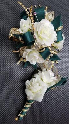 Dark Green Gold and cream wristlet corsage and boutonniere Green Boutonniere, Prom Corsage And Boutonniere, Corsage Wedding, Boutonnieres, Gold Corsage, White Corsage, Flower Corsage, Homecoming Flowers, Prom Flowers