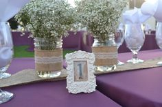 Burlap and lace wedding ideas. Burlap and lace center pieces, with lace table numbers. Baby's breath flowers in mason jars with lace, burlap, and purple theme colors.