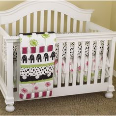 Bold, adorable patterns make up this three-piece crib set by Cotton Tale, including black dots over the white fitted sheet. Contemporary elephants and blocks of pink and green make this comfortable bed set the perfect choice for your little girl.