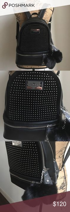 Andrew Marc Backpack Beautiful bag with adjustable straps. Has suede where the studs are located. Two different zipper compartments. Andrew Marc Bags Backpacks