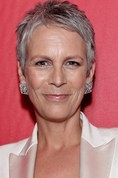 Ultra short gray hair enhances her strong features and personality